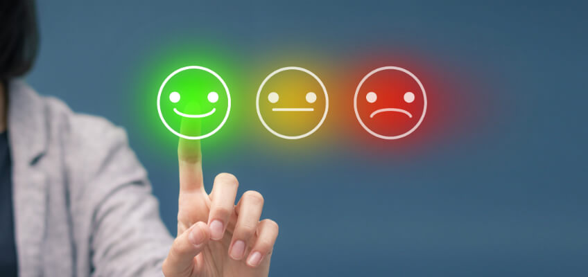 Person choosing happy, OK or sad faces