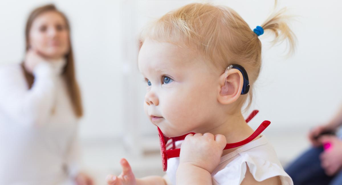 Toddler wearing hearing aid